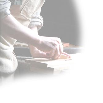 Image of Antique Restorer repairing wooden furniture